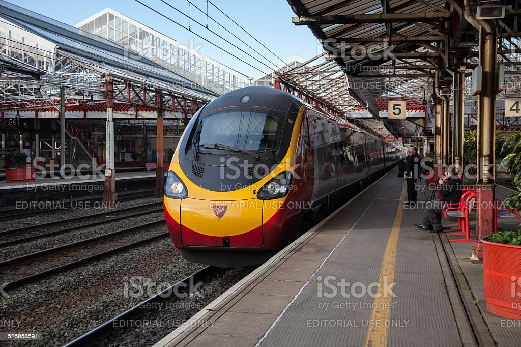 Fare Paying Passengers & a Virgin Trains Pendolino at Crewe stock photo