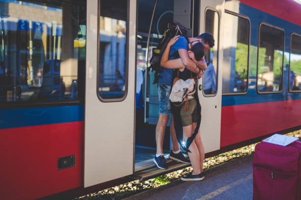 Farewell Photography of a 23 years old couple at railway station. They have a long-distance relationship, and they are separating right now long distance relationship stock pictures, royalty-free photos & images