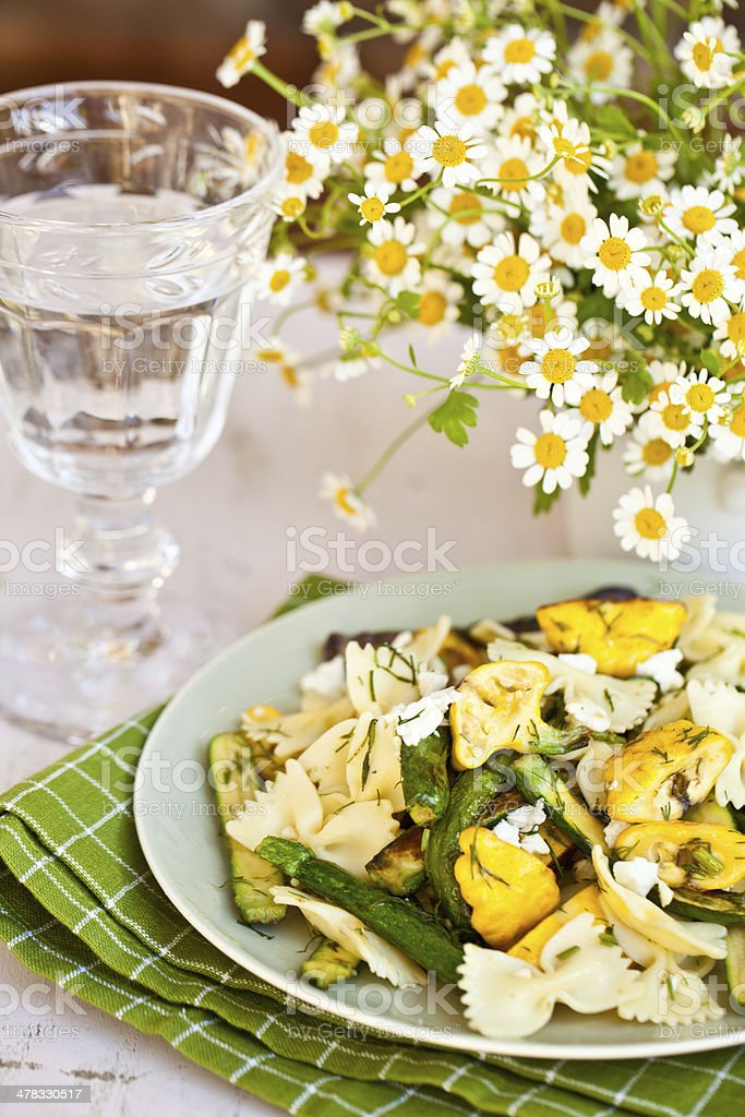 Farfalle Pasta Bowl with Fried Zucchini and Patty Pan Squash. royalty-free stock photo