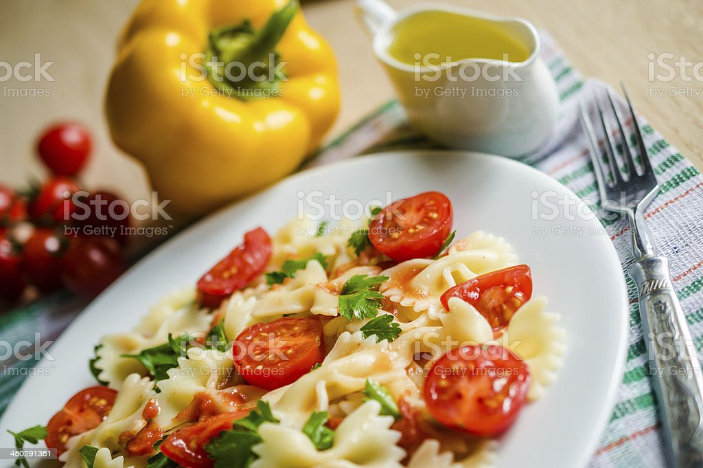 Farfalle pasta with cherry tomatoes stock photo