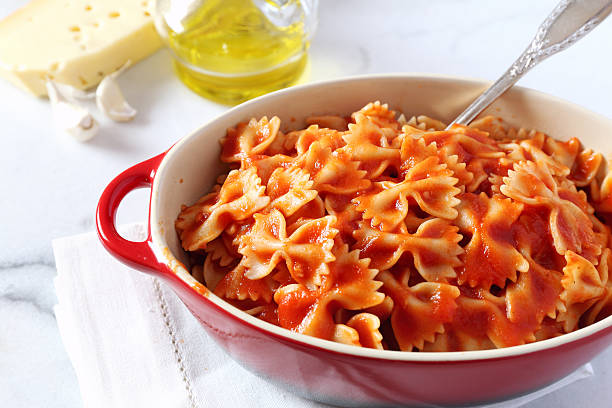 Farfalle pasta with tomato sauce Farfalle pasta with tomato sauce and cheese bow tie pasta stock pictures, royalty-free photos & images