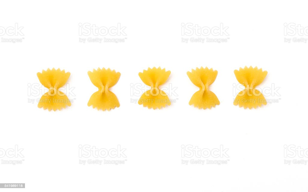Farfalle uncooked, isolated on white background stock photo