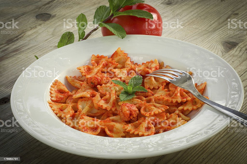 Farfalle with shrimps and tomato sauce stock photo