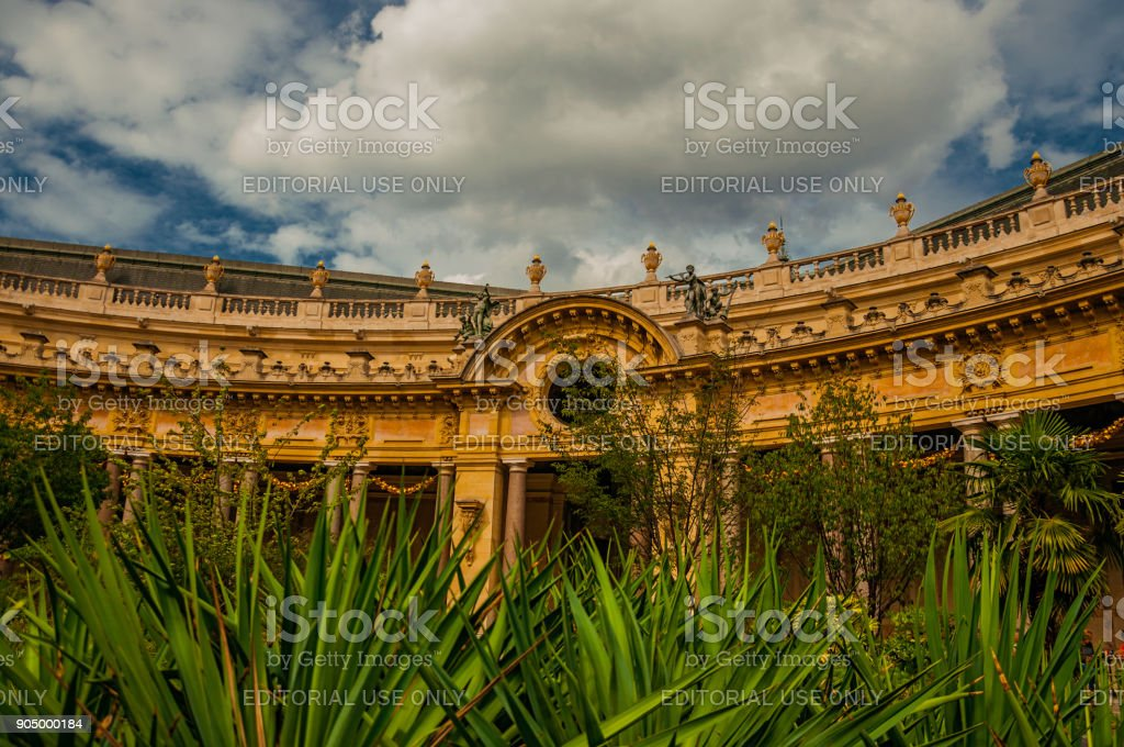 Far-fetched decoration of arch and columns at the Petit Palais courtyard in Paris. stock photo