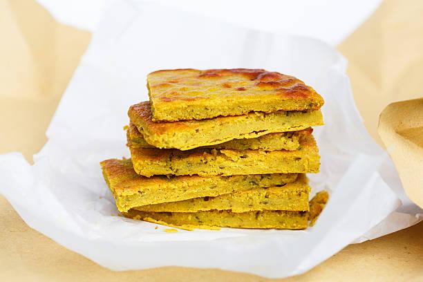 Farinata Farinata (chickpea flour pancake, olive oil, salt and water, Italy) farinata stock pictures, royalty-free photos & images