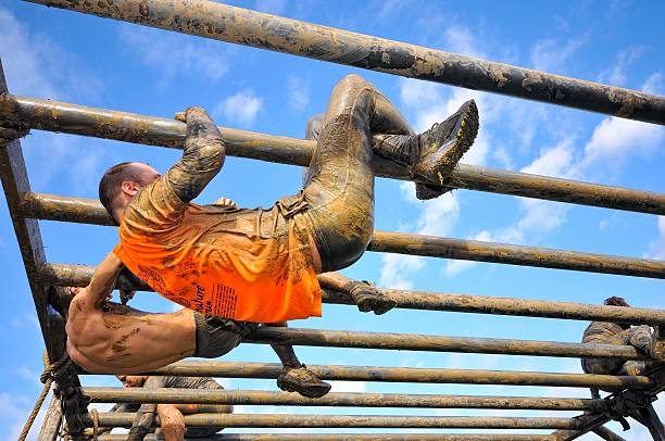 farinato race - extreme obstacle race in gijon, spain. - obstacle run stockfoto's en -beelden