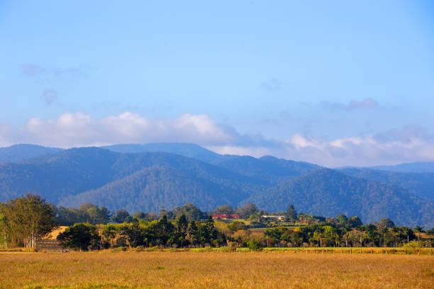 Farm and hills near Tinaroo Falls Dam on the Atherton Tableland in Queensland, Australia stock photo