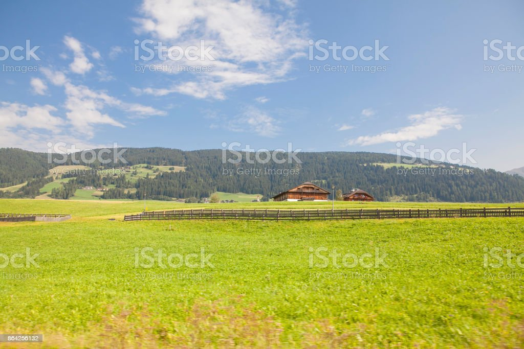 farm at the foot of the mountain royalty-free stock photo