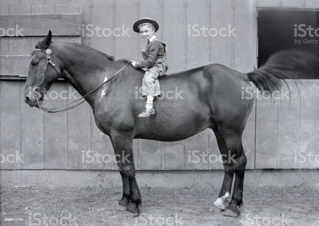 farm boy on draft horse 1931 stock photo