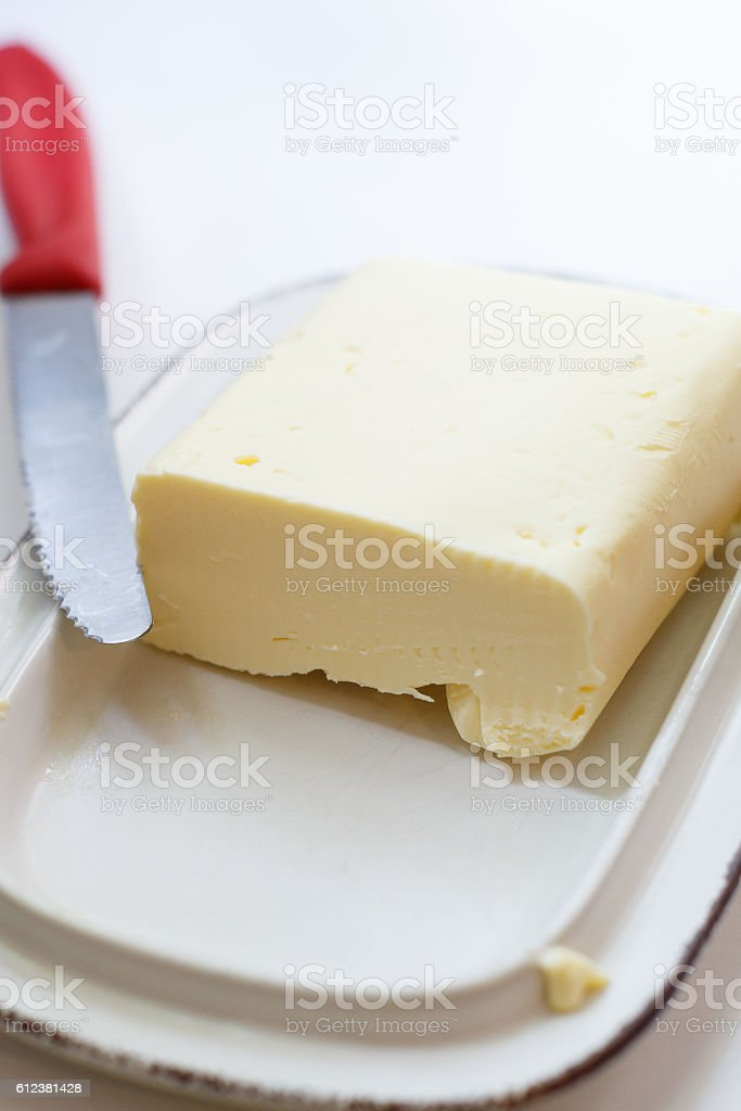 farm butter on a butter dish with a knife stock photo