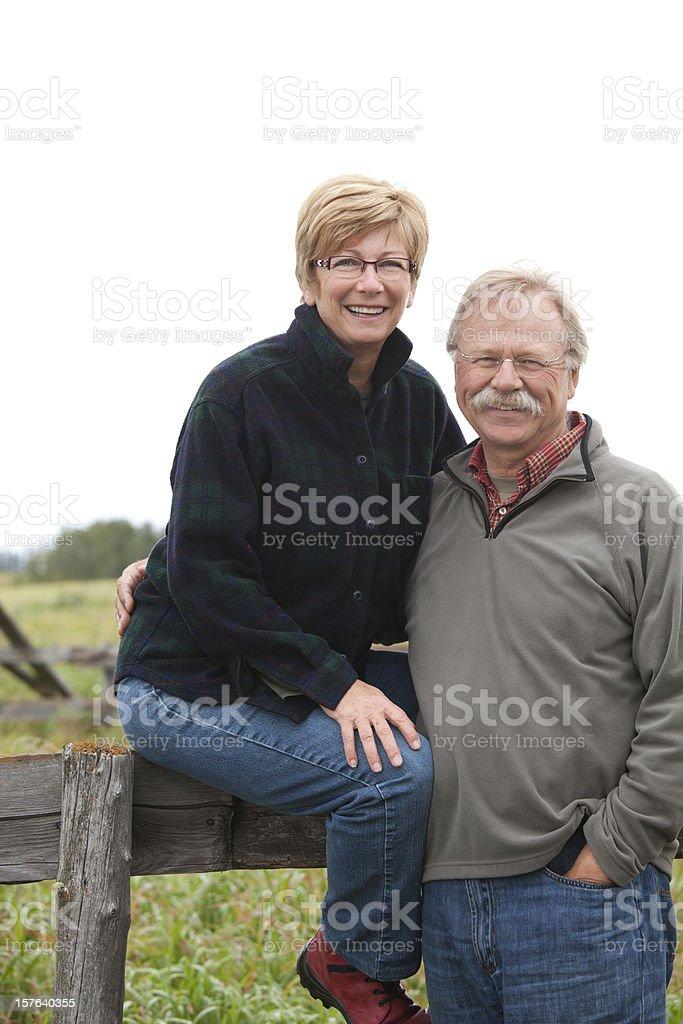 Farm Couple on Fence royalty-free stock photo
