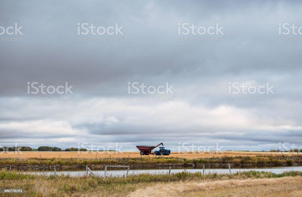 Farm equipment in a field stock photo