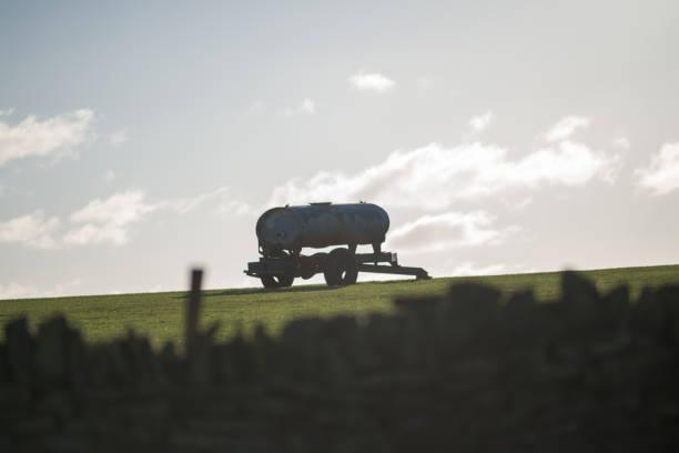 farm equipment on horizon on Yorkshire farm stock photo