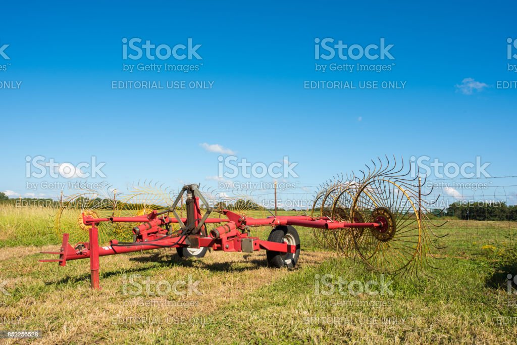 Farm equipment for aerating a field, on a farm in upstate South...