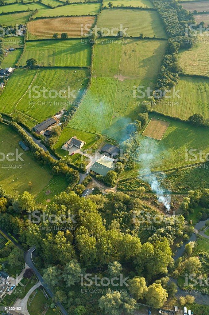 Farm, fields and smoke stock photo