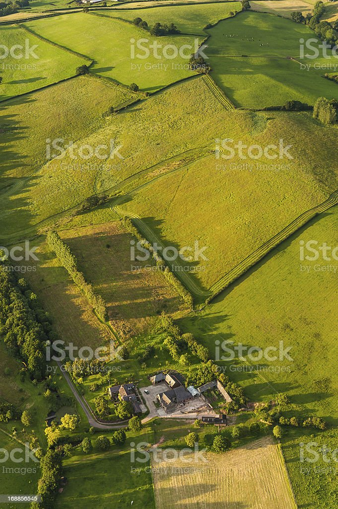 Farm fields green summer patchwork quilt aerial landscape royalty-free stock photo