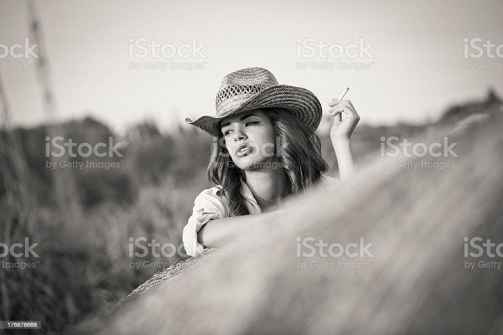 Farm Girl Taking A Rest, Smoking Cigarette stock photo