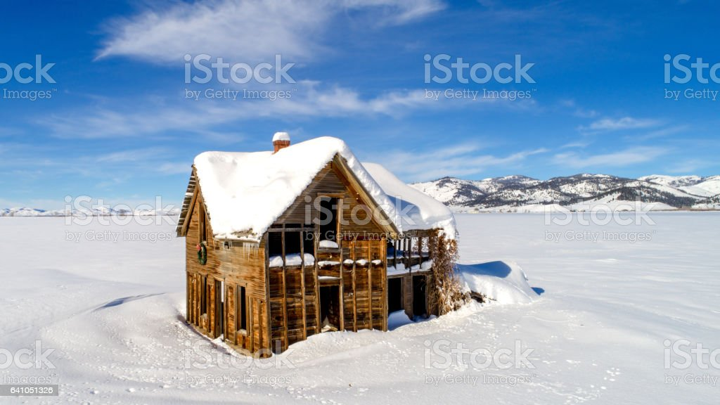 Farm house and mountains with winter show stock photo