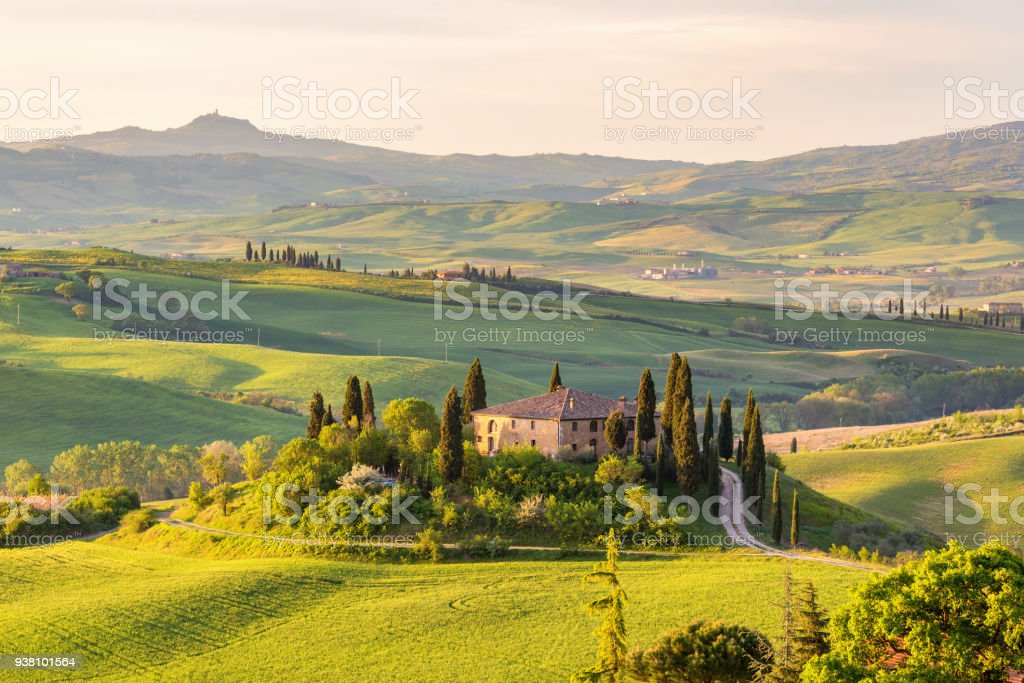 Farm house on a hill in Tuscany landscape stock photo