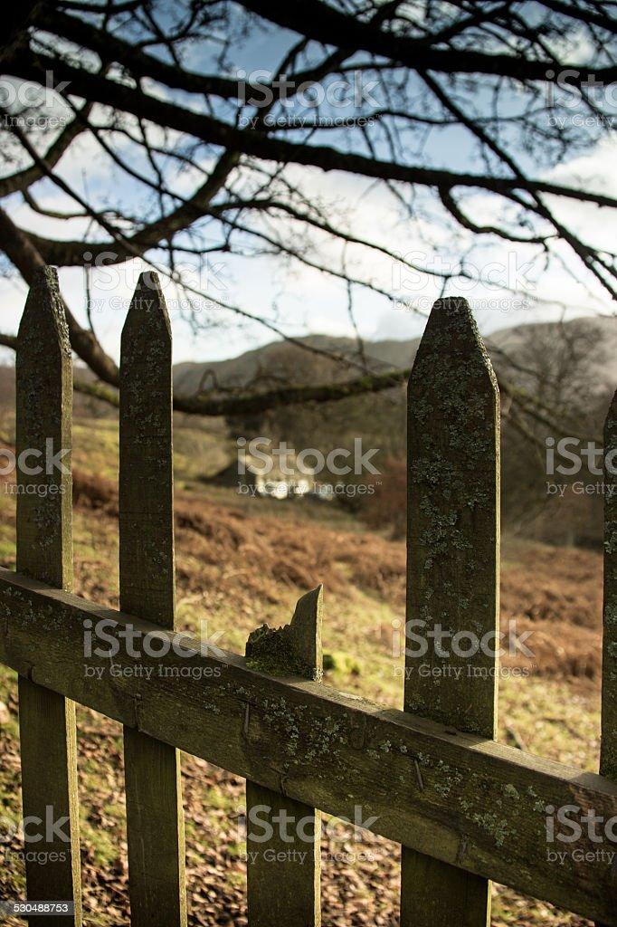 Farm House Through a Wooden Fence stock photo
