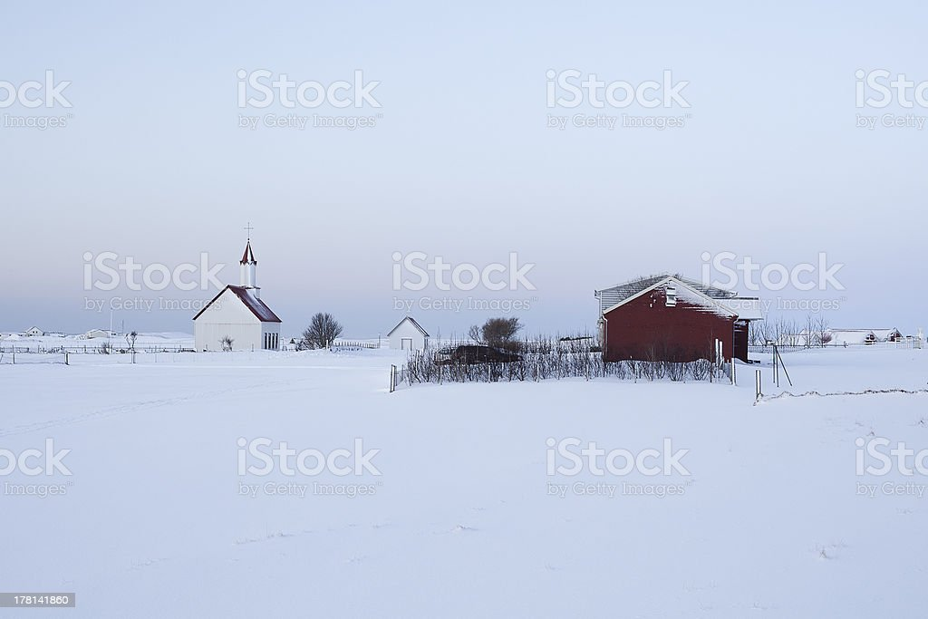 Farm in a grey, snowy weather royalty-free stock photo