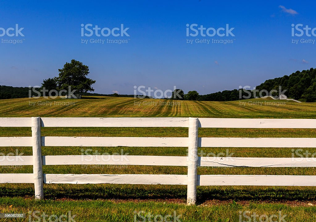 Farm in Maryland with freshly painted white fence royalty-free stock photo