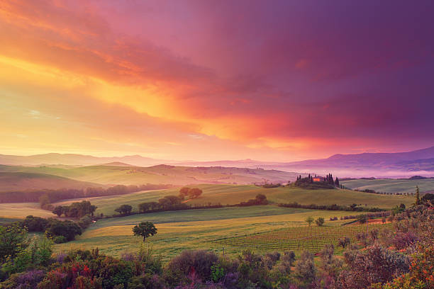 Farm in Tuscany at dawn dawn in Tuscany with wonderful clouds dusk stock pictures, royalty-free photos & images