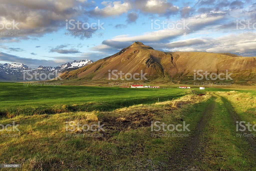 Farm land with road- snaefellsnes stock photo