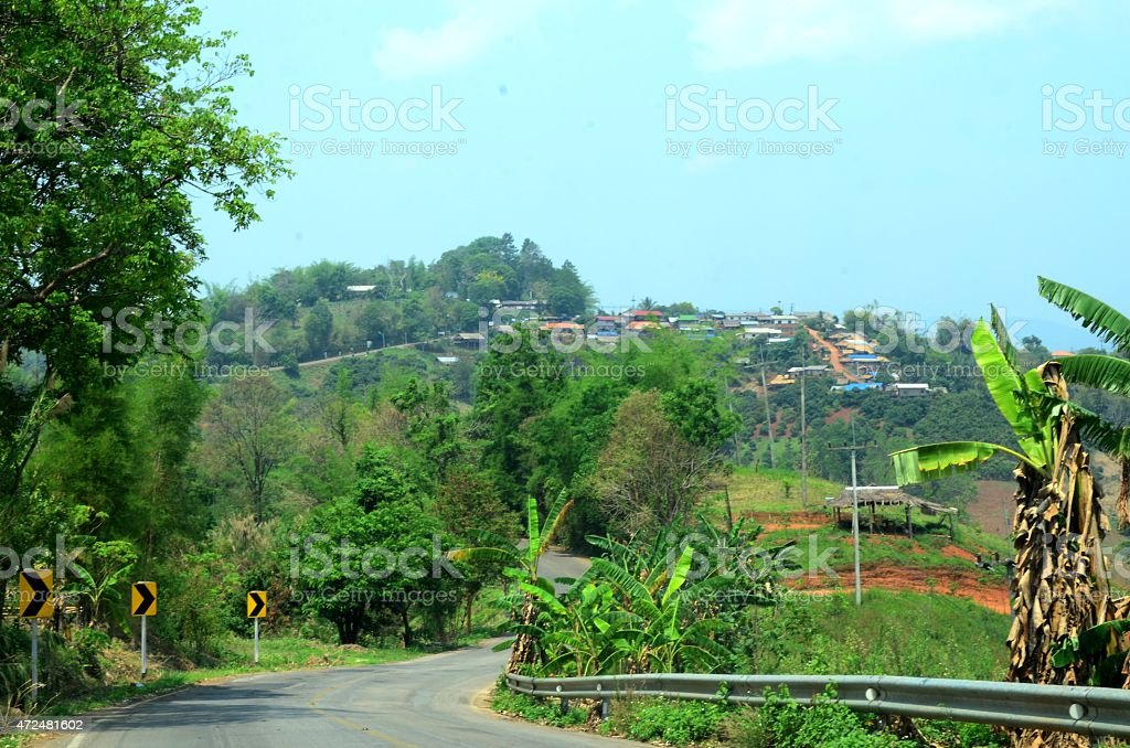 Farm road to tribe hill village. Thailand. stock photo