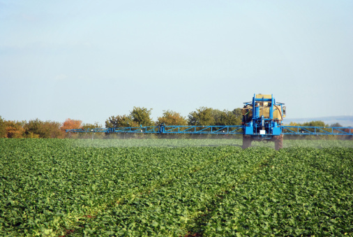 istock A farm sprayer distributes liquid chemicals to the crops  157307221