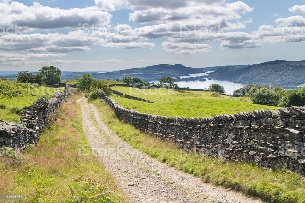 Farm track leading down to Lake Windemere stock photo