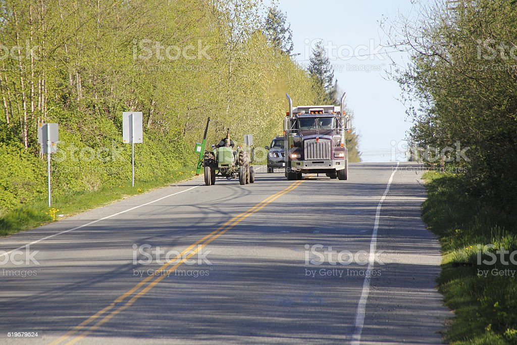 Farm Vehicles and Road Traffic stock photo