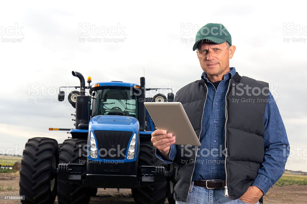 Farmer and Computer royalty-free stock photo