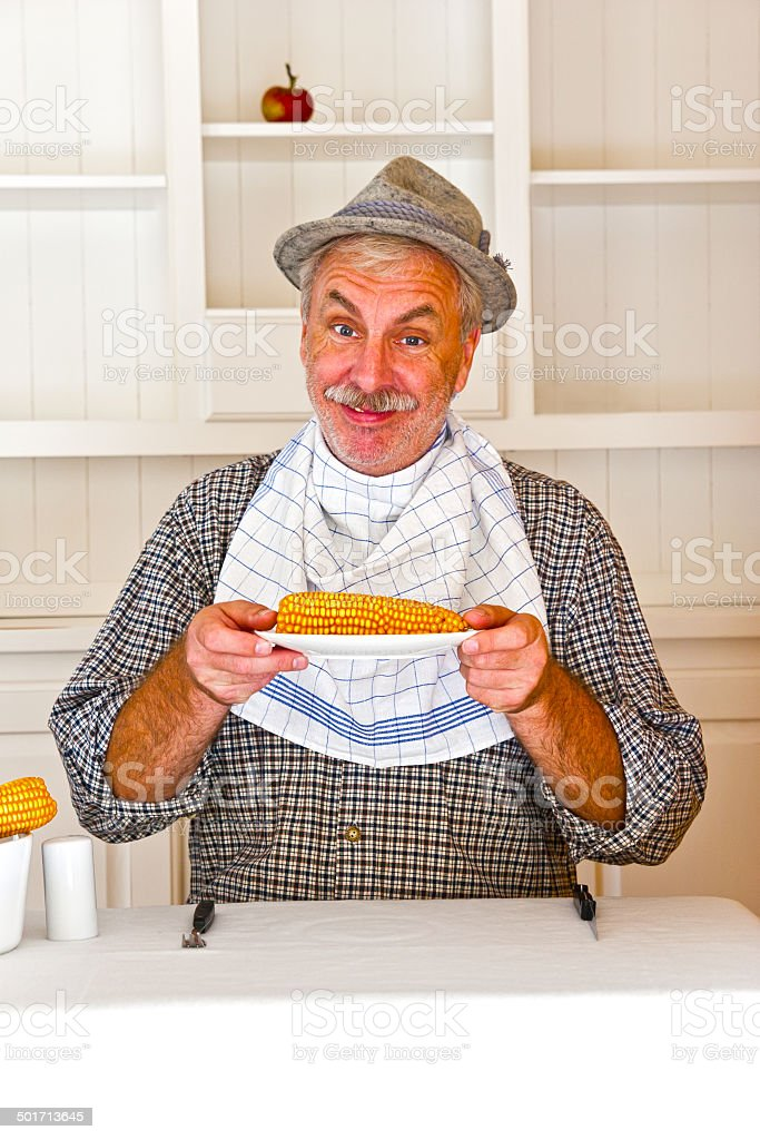 Farmer and his corncob meal stock photo