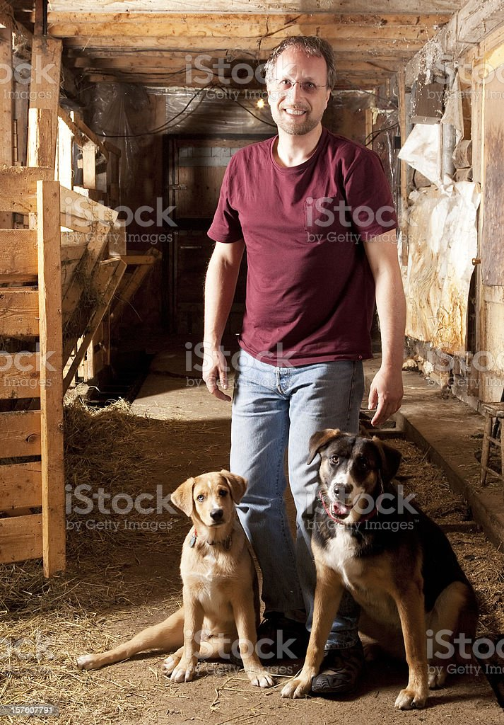 Farmer and his two dogs royalty-free stock photo