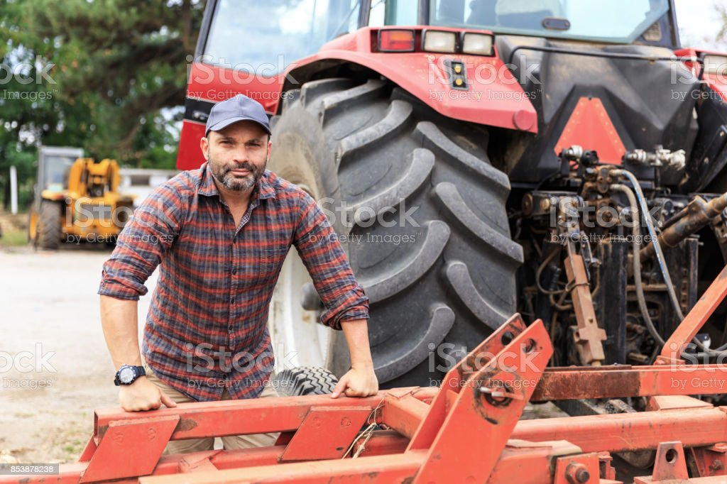 Farmer and red tractor stock photo