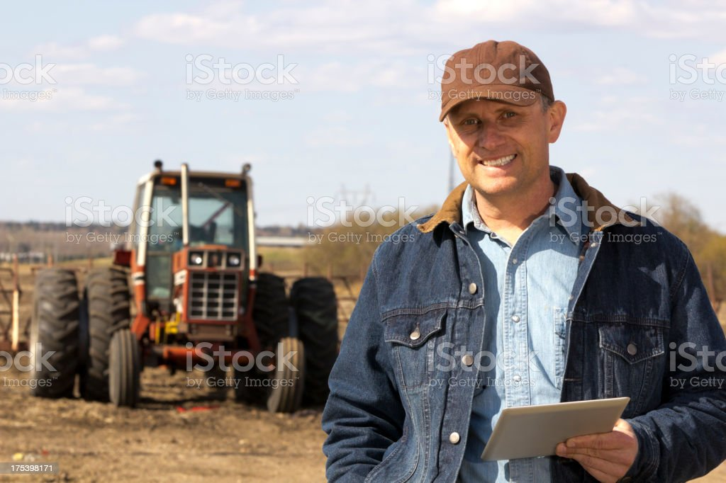 Farmer and Tablet PC royalty-free stock photo