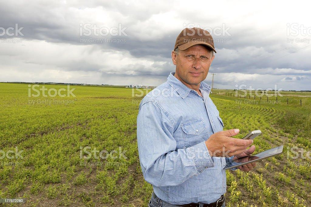 Farmer and Wireless Communication royalty-free stock photo