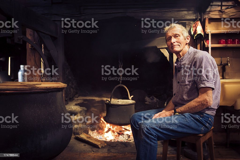 farmer by the fireplace royalty-free stock photo