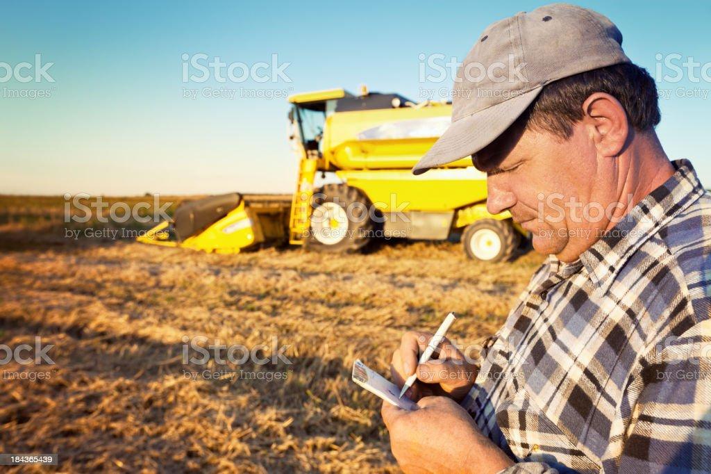 Farmer calculate royalty-free stock photo