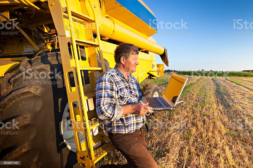 Farmer calculates earnings stock photo