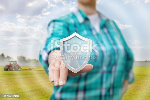 istock Farmer clicks on the icon of quality assurance. 957479580