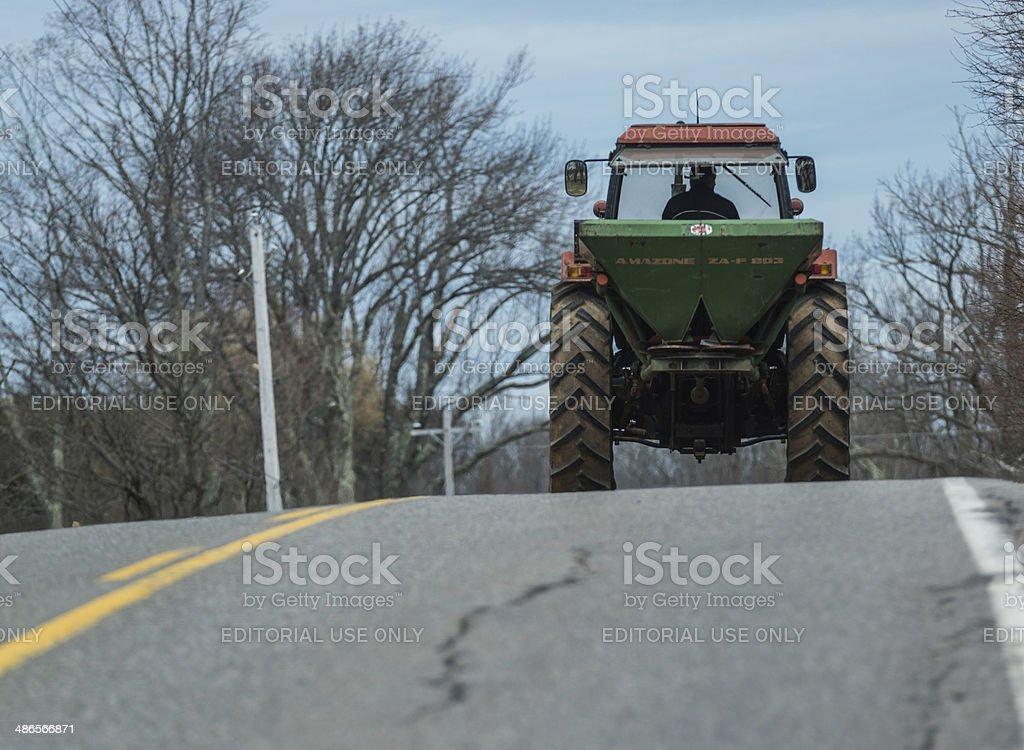 Farmer Drives Tractor royalty-free stock photo