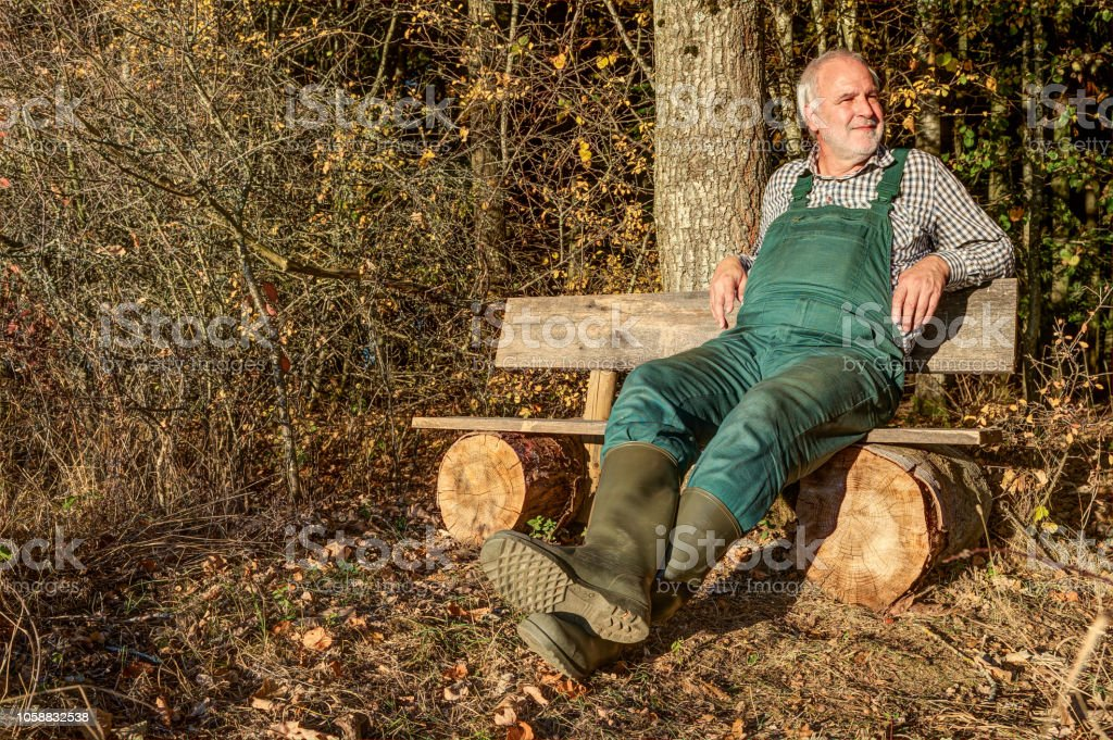 Farmer enjoys the evening. - Royalty-free Adult Stock Photo