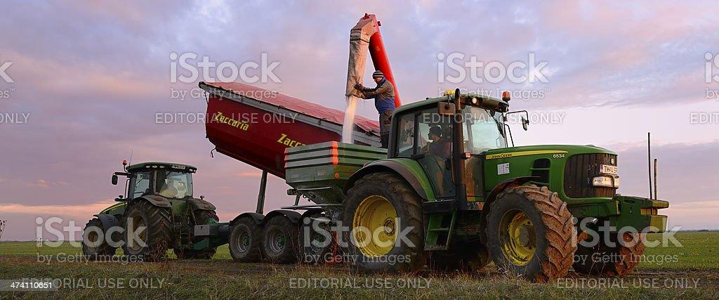 Farmer Filling Fertilizer Spreaders with Urea stock photo