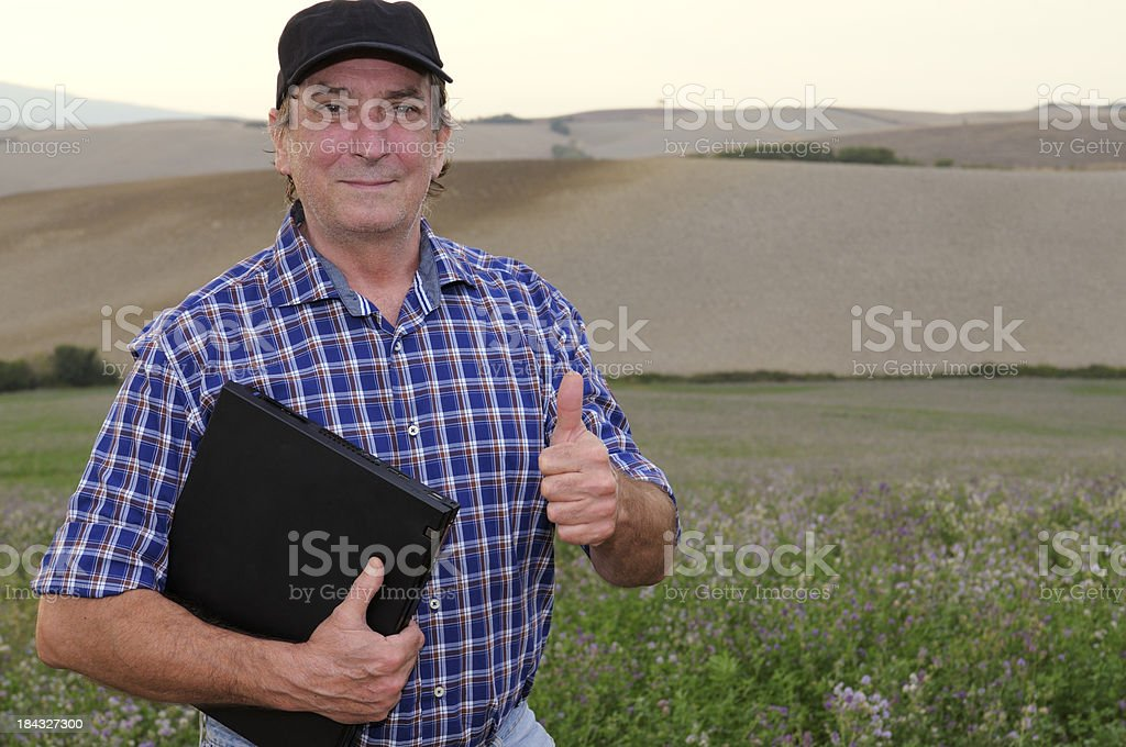 Farmer Giving Thumbs Up in the Countryside royalty-free stock photo