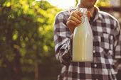 farmer holding a fresh natural milk in bottle