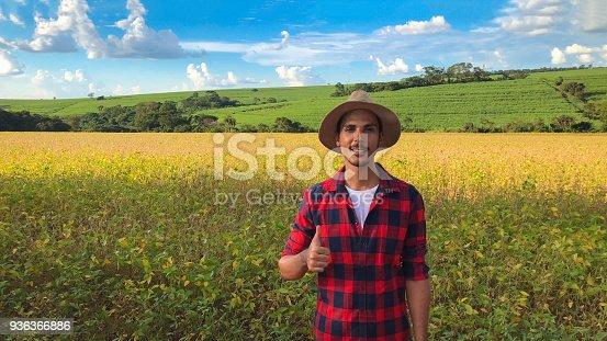 istock Farmer in soybean field plantation 936366886