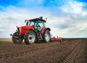 istock Farmer in tractor preparing land for sowing 483452213