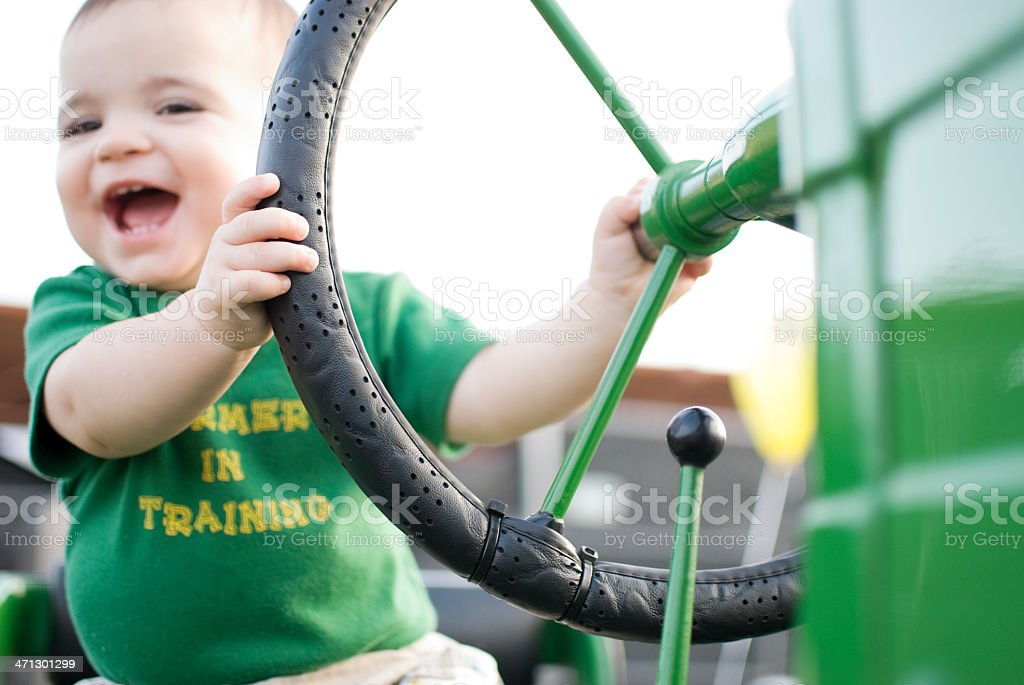 Farmer In Training: Toddler on a Vintage Green Tractor royalty-free stock photo